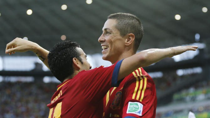 Spain's Fernando Torres, right, is congratulated by Pedro Rodriguez after scoring his side's 2nd goal during the soccer Confederations Cup group B match between Nigeria and Spain at the Castelao stadium in Fortaleza, Brazil, Sunday, June 23, 2013. (AP Photo/Fernando Llano)