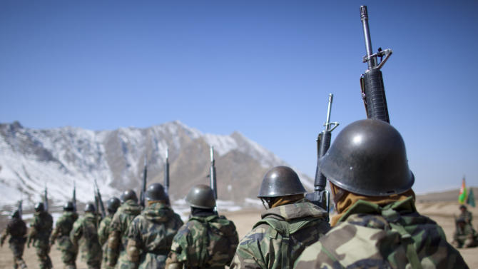 Afghan National Army soldiers line up to march to a training session at the Kabul Military Training Center, KMTC, on the outskirts of Kabul, Afghanistan, Thursday, March 8, 2012. The Afghan National Army will be tasked with providing security throughout Afghanistan after the last international troops pull out in 2014. (AP Photo/Anja Niedringhaus)
