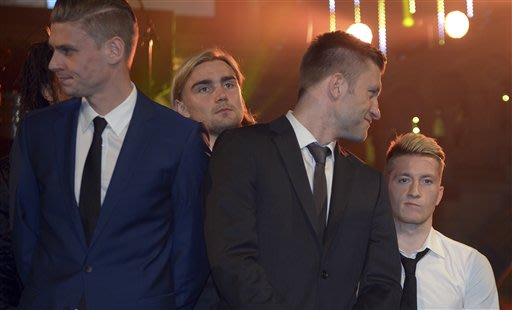 Dortmund's Lukasz Piszczek, Marcel Schmelzer, Jakub Blaszczykowski and Marco Reus react during the club's party at the Natural History Museum in London, England, Sunday morning May 26,  2013. Borussia