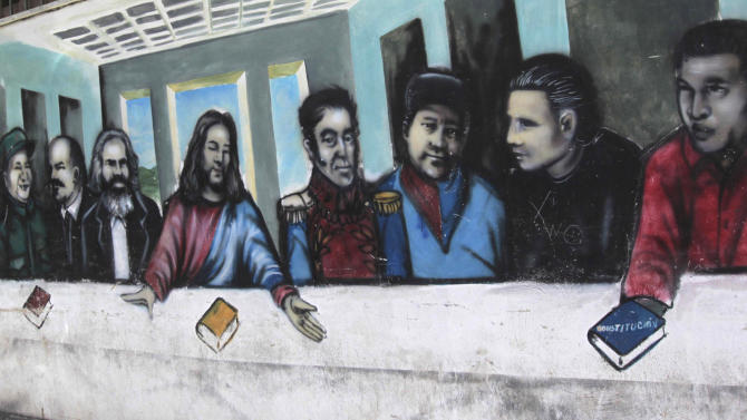 FILE - In this March 5, 2012 file photo, a mural imitating the religious painting The Last Supper covers a wall of a popular housing complex, showing from left to right, Fidel Castro, Ernesto 'Che' Guevara, Mao Tse-tung, Vladimir Lenin, Karl Marx, Jesus Christ, Simon Bolivar, Venezuelan rebel fighters Alexis Gonzalez and Fabricio Ojeda and Venezuela's President Hugo Chavez in Caracas, Venezuela. For his loyal followers, Chavez was already a living legend on par with independence era hero Simon Bolivar even before his March 5 death from cancer. In a mere three weeks, however, Chavez has ascended to divine status, at least according to political rhetoric, as the government and his die-hard loyalists build a religious mythology around him ahead of April 14 elections scheduled to pick a new leader. (AP Photo/Fernando Llano, File)