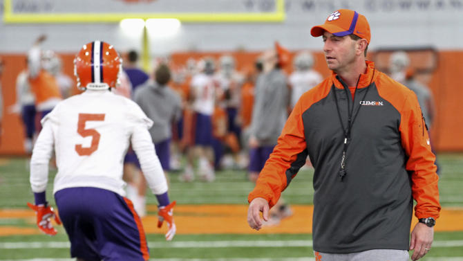 Clemson coach Dabo Swinney, right, watches the first day of NCAA college football spring practice for the team, Wednesday, March 5, 2014, in Clemson, S.C