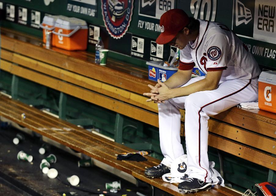Washington Nationals relief pitcher Tyler Clippard sits in the dugout after the second baseball game of a doubleheader against the Los Angeles Dodgers at Nationals Park, Wednesday, Sept. 19, 2012, in Washington. Clippard gave up a home run in the ninth and the Dodgers won the second game 7-6. (AP Photo/Alex Brandon)