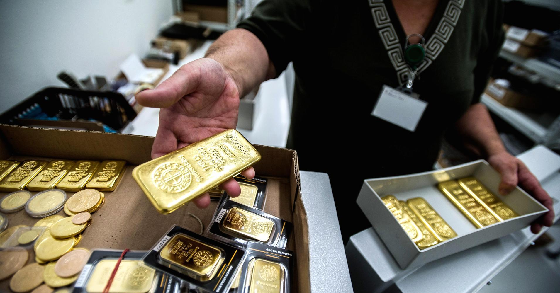 Gold rally gathers steam; settles up $5.60