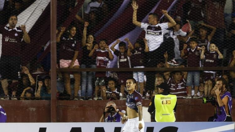 Ayala of Lanus reacts after scoring team's first goal against Ponte Preta during Copa Sudamericana final soccer match in Buenos Aires