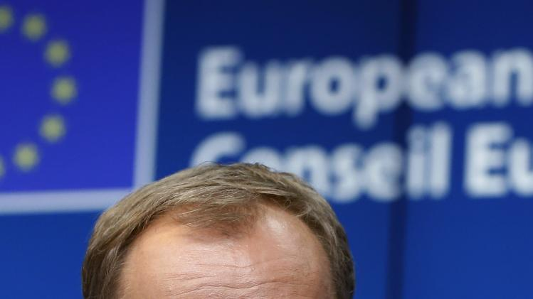 Newly elected European Council President Tusk attends a news conference during a EU summit in Brussels