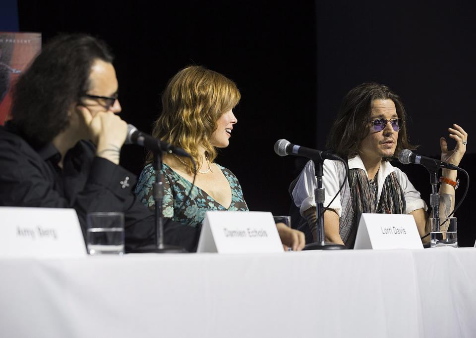 "Actor Johnny Depp, right, speaks at the press conference for documentary ""West of Memphis"" at the 2012 Toronto International Film Festival in Toronto on Saturday, Sept. 8, 2012. (AP Photo/The Canadian Press, Michelle Siu)"
