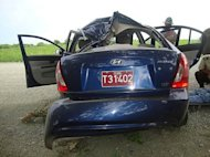 <p>The crashed car of Cuban dissident Oswaldo Paya is pictured in this image from the Interior Ministry released by Cuban TV. Paya's widow has rejected a government report that blamed the car crash that killed her husband on the driver, saying she had been denied access to information.</p>
