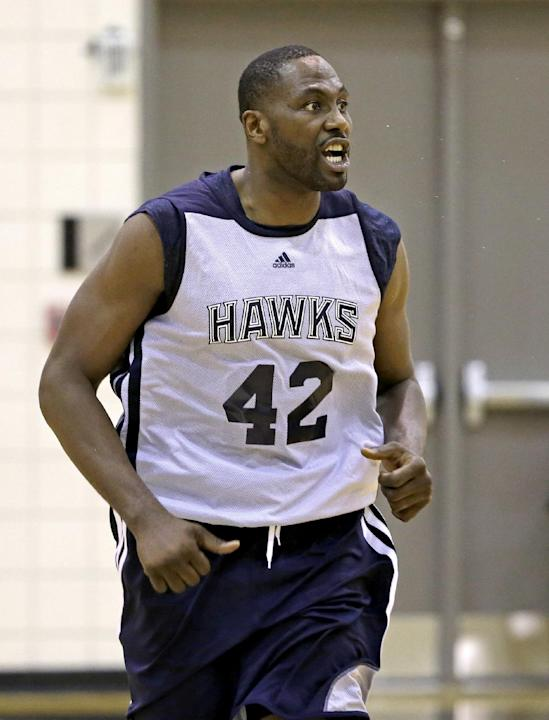 Atlanta Hawks' Elton Brand runs up the court during NBA basketball training camp, Tuesday, Oct. 1, 2013, in Athens, Ga