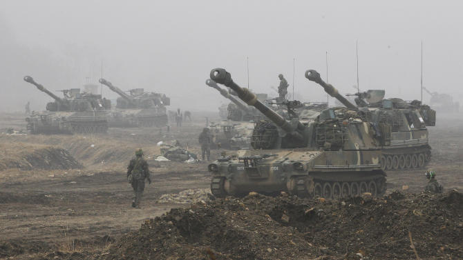 South Korean Marine K-55 self-propelled howitzers are on positions during an exercise against possible attacks by North Korea near the border village of Panmunjom in Paju, South Korea, Wednesday, April 3, 2013. (AP Photo/Ahn Young-joon)