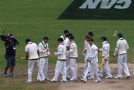 Australia's team celebrate after winning the second Ashes cricket test against England at the Adelaide Oval December 9, 2013. REUTERS/David Gray