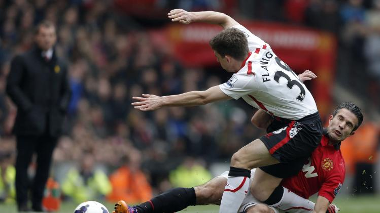 Manchester United's van Persie challenges Liverpool's Flanagan during their English Premier League soccer match in Manchester