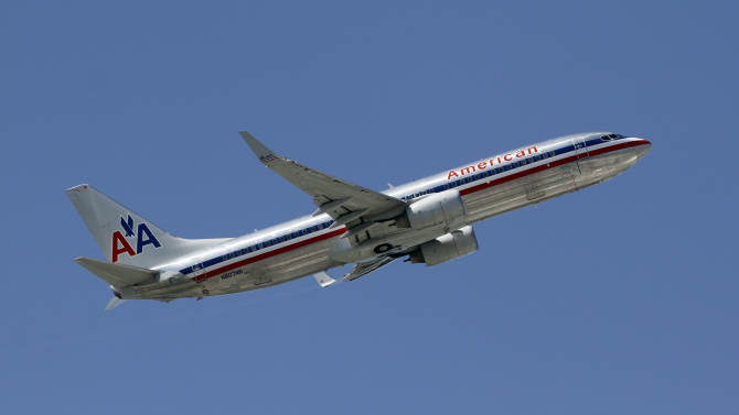 This  Monday, Aug. 20, 2012, photo, shows an American Airlines aircraft taking off at Miami International Airport in Miami. American Airlines says Tuesday, Oct. 2, 2012, passenger seats on a third flight came loose during flight and it's continuing to inspect other jets with similar seating. The discovery occurred after similar incidents since last week. (AP Photo/Alan Diaz)