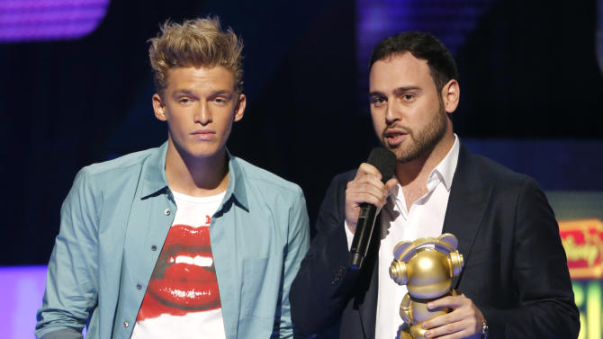 Cody Simpson and Scooter Braun onstage during the Radio Disney Music Awards at the Nokia Theatre on Saturday, April 27, 2013 in Los Angeles. (Photo by Todd Williamson /Invision/AP)