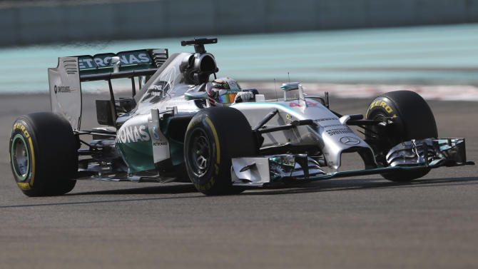 Mercedes driver Lewis Hamilton of Britain steers his car during the first practice session at the Yas Marina racetrack in Abu Dhabi, United Arab Emirates, Friday, Nov. 21, 2014. The Emirates Formula One Grand Prix will take place on Sunday. (AP Photo/Kamran Jebreili)