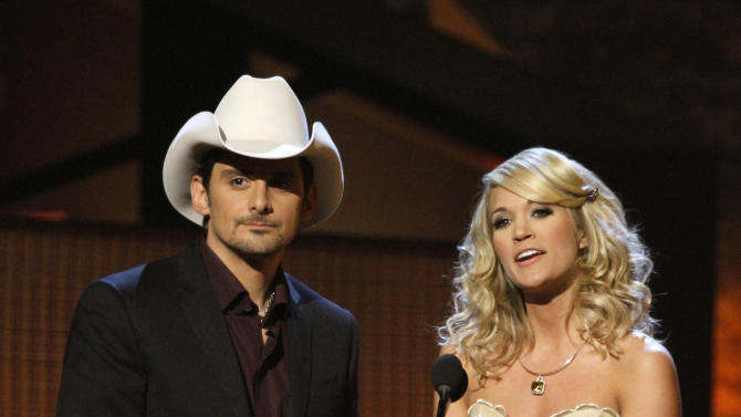FILE - In this Nov. 11, 2009 file photo, country singers Brad Paisley, left, and Carrie Underwood host the 43rd Annual Country Music Awards in Nashville, Tenn.  Paisley and Underwood are hosting the 45th annual CMA Awards live from the Bridgestone Arena in Nashville, Tenn., on Wednesday, Nov. 9. It is the fourth time the couple has hosted together. (AP Photo/Mark Humphrey, file)