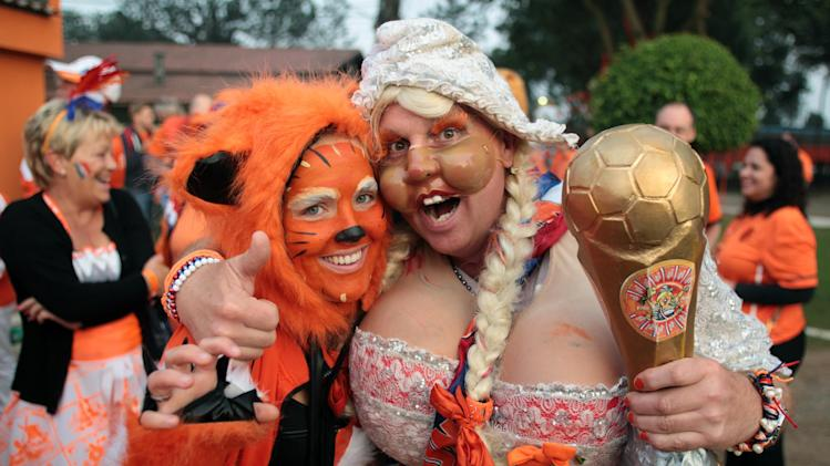 Dutch fans head for the Arena Corinthians soccer stadium in Sao Paulo