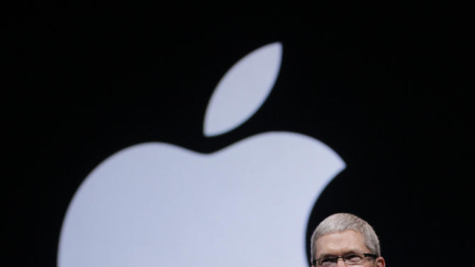 Apple CEO Tim Cook walks on stage at the beginning of an event in San Francisco, Wednesday, Sept. 12, 2012.  Apple is holding an event in San Francisco during which it is expected to announce a new iPhone capable of faster data speeds. It may also come with a taller screen. (AP Photo/Eric Risberg)