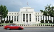 The US Federal Reserve building is seen on August 9, 2011 in Washington, DC. The US Federal Reserve left unchanged near-zero interest rates and its massive bond-buying program on Wednesday, saying growth was modest in the world's largest economy