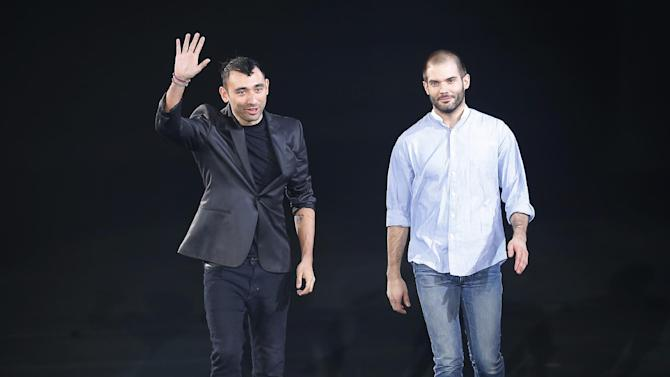 FILE - In this Feb.27, 2013 file photo shows fashion designers Nicola Formichetti, left, and Sebastien Teigne after their fashion collection for Thierry Mugler's Ready to wear Fall/Winter 2013/2014 presented in Paris. Mugler have said Tuesday, April, 2, 2013 that Lady Gaga's stylist Nicola Formichetti is leaving the French fashion house where he's been creative director since March 2011. (AP Photo/ Jacques Brinon, File)
