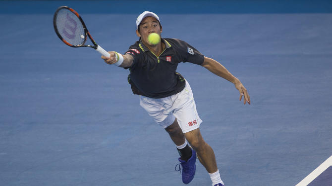 Kei Nishikori of Japan returns the ball to Kevin Anderson of South Africa during a  Mexican Tennis Open semifinal match in Acapulco, Mexico, Friday, Feb.  27, 2015. (AP Photo/Christian Palma)