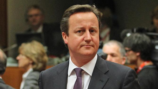 British Prime Minister David Cameron looks on as he attends the EU Budget summit at the European Council building in Brussels, Thursday, Feb. 7, 2013. European Union leaders drew hard lines Thursday ahead of a struggle over EU spending for the next seven years that reflects deep divisions about the role of their union. (AP Photo/Yves Logghe)