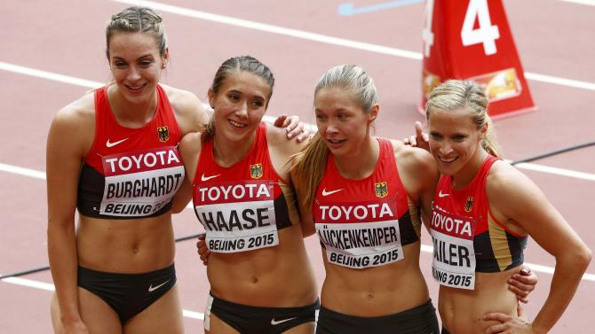 Germany's Alexandra Burghardt, Rebekka Haase, Gina Luckenkemper and Verena Sailer (L-R) after competing in the women's 4 x 100 metres relay heat during the 15th IAAF World Championships at the National Stadium in Beijing