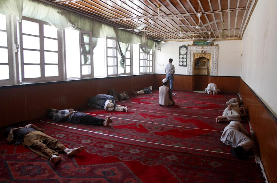 Afghan Muslim men sleep in a mosque as they wait to break their fast in Kabul, Afghanistan, Thursday, Aug. 16, 2012. (AP Photo/Ahmad Jamshid)