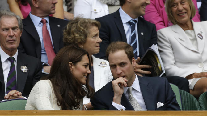Britain's Prince William, right, and his wife Kate, Duchess of Cambridge, left, speak to each other ahead of a quarterfinals match between Roger Federer of Switzerland and Mikhail Youzhny of Russia at the All England Lawn Tennis Championships at Wimbledon, England, Wednesday July 4, 2012. (AP Photo/Anja Niedringhaus)