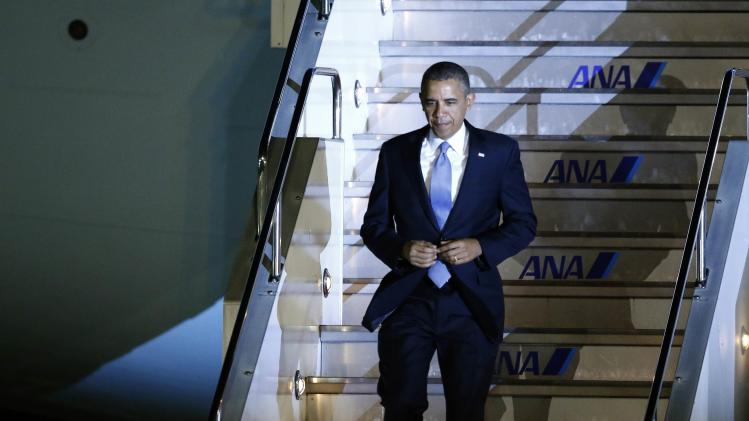 U.S. President Obama walks down the steps of Air Force One as he arrives at Haneda International Airport in Tokyo