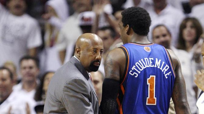 New York Knicks forward Amare Stoudemire (1) is patted on the butt by head coach Mike Woodson after Stoudemire fouled out during the second half of an NBA basketball game in the first round of the Eastern Conference playoffs against the Miami Heat, Wednesday, May 9, 2012, in Miami. The Heat won 106-94 to win the series 4-1 and advance to the second round. (AP Photo/Wilfredo Lee)