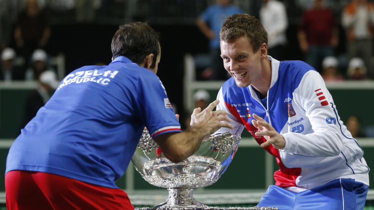 Czech Republic's Radek Stepanek, left, and Tomas Berdych, right, celebrate with the trophy after defeating Spain in their Davis Cup finals tennis match in Prague, Czech Republic, Sunday, Nov. 18, 2012. Czech Republic defeated Spain 3-2 and gained the Davis Cup trophy. (AP Photo/Petr David Josek)