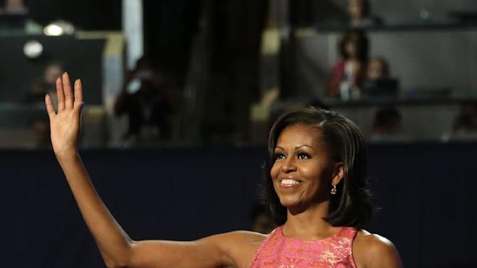 First Lady Michelle Obama waves to delegates at the Democratic National Convention in Charlotte, N.C., on Monday, Sept. 3, 2012.  (AP Photo/Charles Dharapak)