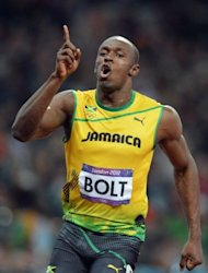 Jamaica?s Usain Bolt celebrates after winning the gold medal in the men&#39;s 100m final at the London 2012 Olympics on August 5, 2012. Bolt has been awarded the Overseas Personality of the Year award at a glittering ceremony in London