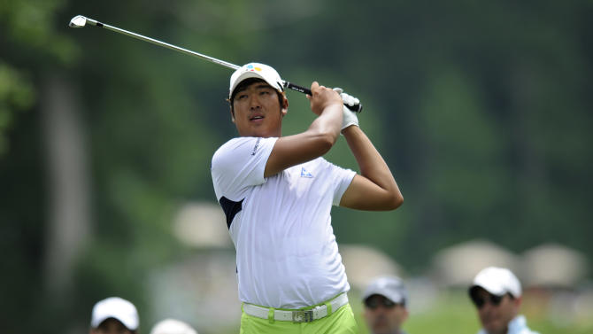 D.H. Lee, of South Korea, watches his drive from the seventh tee during the second round of the AT&T National golf tournament at Congressional Country Club, Friday, June 28, 2013, in Bethesda, Md. (AP Photo/Nick Wass)