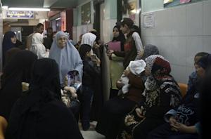 Working class Egyptians queue for check-ups at an Islamic…