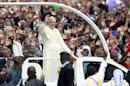 Pope Francis waves to the faithful as he arrives for a Papal mass in Kenya's capital Nairobi