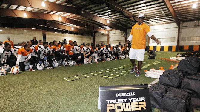 IMAGE DISTRIBUTED FOR DURACELL - Dallas defensive lineman DeMarcus Ware unveils donated football equipment to the Lancaster Tigers on Tuesday, Nov. 13, 2012inLancaster, Texas. DeMarcus joined Duracell Trust Your Power program to encourage youth to realize their power to achieve their goals. (Photo by Brandon Wade/Invision for Duracell/AP Images)