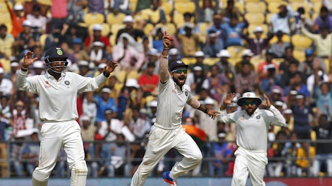 India's captain Kohli along with his teammates Pujara and Sharma appeal unsuccessfully for the wicket of South Africa's Plessis during the third day of their third test cricket match in Nagpur