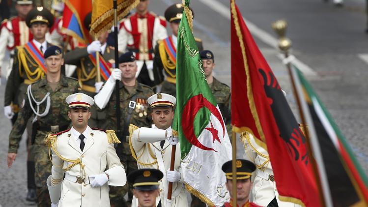 The Algerian flag is carried by participants of the traditional Bastille Day parade on the Champs Elysees in Paris