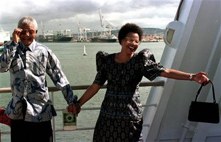 File picture shows South African President Nelson Mandela adjusting his sunglasses as he and his companion Grace Machel set sail aboard the QE II cruise ship in Durban harbour, for Cape Town