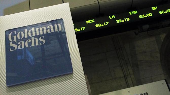 A Goldman Sachs sign is seen over their kiosk on the floor of the New York Stock Exchange