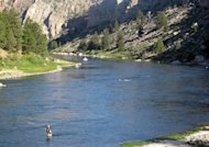In this Aug. 1, 2012 photo, Steve Connole fishes in the Missouri River. More anglers are fishing on larger rivers and earlier in the day as heat and drought lead to restrictions on several small streams in Montana and in Yellowstone National Park. (AP Photo/Matt Volz)