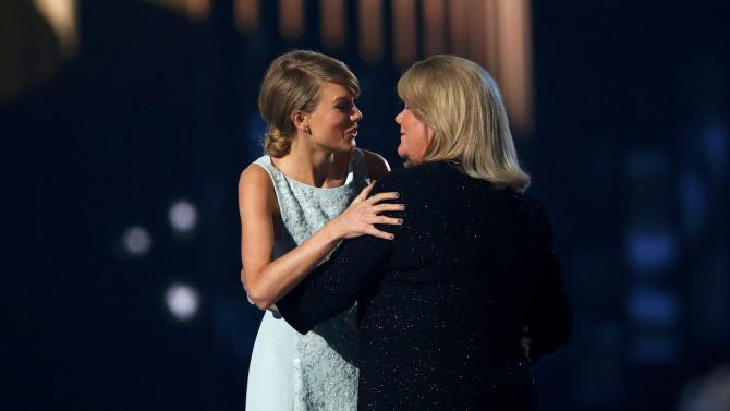 Taylor Swift accepts the Milestone Award from her mother Andrea at the 50th Annual Academy of Country Music Awards in Arlington