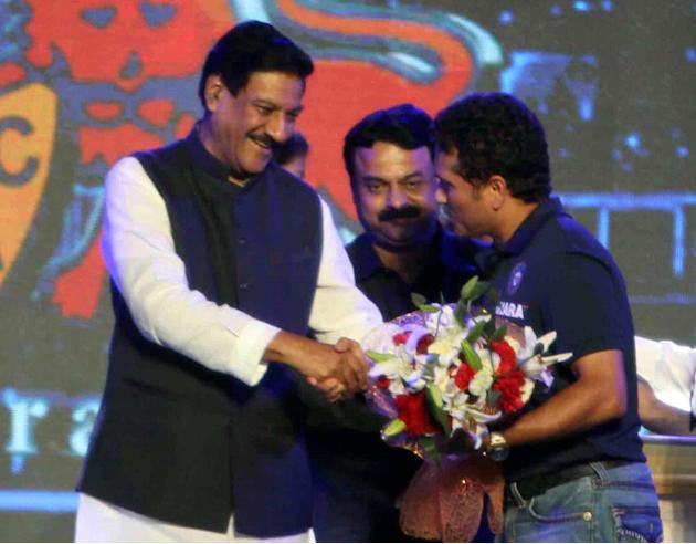 Maharashtra Chief Minister Prithviraj Chavan felicitates Indian cricketer Sachin Tendulkar during the rechristening ceremony of MCA sport complex at Kandivali West Mahavir Nagar as `Sachin Tendulkar G