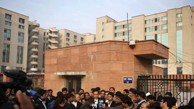 Ajay Prakash Singh, center, lawyer for two of the accused, speaks to the journalists outside the Saket district court complex where the accused in a gang rape are to be tried, in New Delhi, India, Monday, Jan. 14, 2013. The lawyer for one of the five men charged in the fatal gang rape of a woman on a moving New Delhi bus said Monday that his client is a minor and asked a court to order a medical test to determine his age. (AP Photo/Tsering Topgyal)