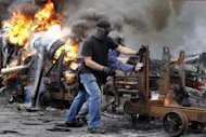 &lt;p&gt;Spanish miners burn tires during a protest in Caborana, near Oviedo last weeks to oppose cuts in subsidies. Spain was back in the firing line on the markets on Monday as eurozone finance ministers prepared to follow up on measures agreed at a summit late last month to tackle the debt crisis.&lt;/p&gt;