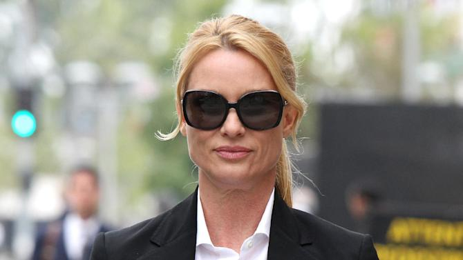 "FILE - In this March 13, 2012 file photo, ""Desperate Housewives"" star, Nicollette Sheridan arrives at court in Los Angeles. An appeals court in Los Angeles ruled Thursday August 16, 2012 that Sheridan is not entitled to a new trial on her claim that she was wrongfully fired from the series ""Desperate Housewives,"" but that she should be allowed to pursue a claim she was retaliated against for complaining about an unsafe work condition. (AP Photo/Nick Ut, file)"