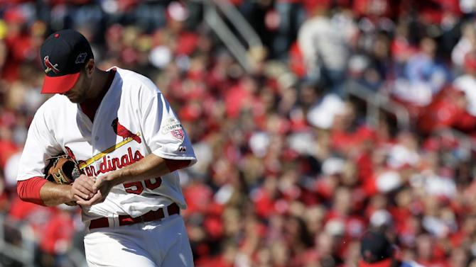St, Louis Cardinals starting pitcher Adam Wainwright, left, sweeps at the mound after walking a Washington Nationals playerin second inning action during Game 1 of the National League division baseball series on Sunday, Oct. 7, 2012, at Busch Stadium in St. Louis, Mo. (AP Photo/The St. Louis Post-Dispatch, Chris Lee)  EDWARDSVILLE INTELLIGENCER OUT; THE ALTON TELEGRAPH OUT