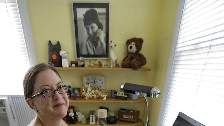 This photo taken Oct. 9, 2012 shows Erin Mitchell working on her computer at her home in St. Petersburg, Fla. Which way Florida swings in presidential elections is largely due to the transient nature of its population. A constant influx of new residents, like Mitchell, can make a difference from one election cycle to the next. Mitchell moved to Florida from Boston and had lived in Chicago before that. She used to be a Democrat, then registered as a Republican and is now an independent. She voted for Republican George W. Bush in 2000, but went for Democrats John Kerry in 2004 and Barack Obama in 2008.   (AP Photo/Chris O'Meara)
