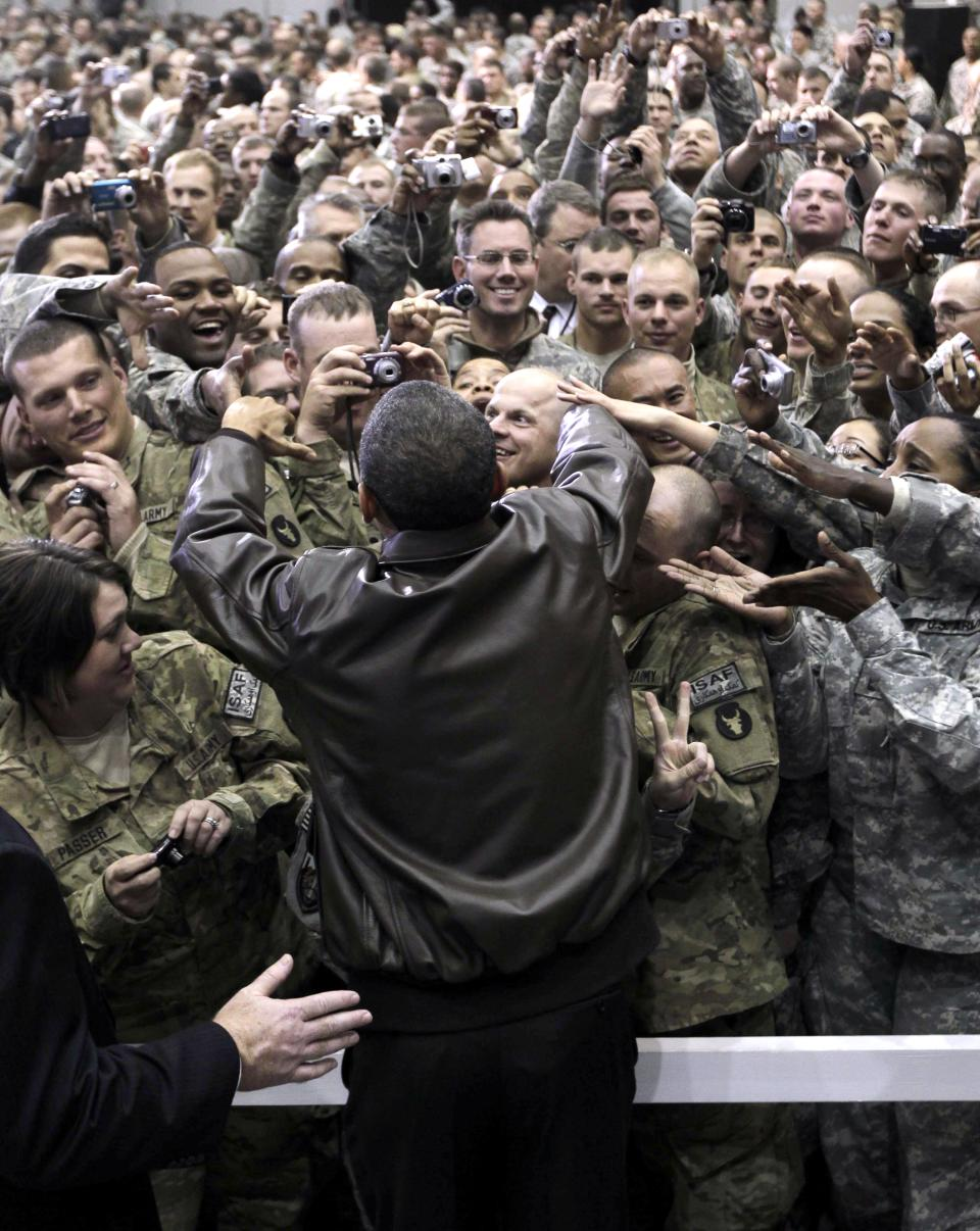 President Barack Obama greets troops at a rally during an unannounced visit at Bagram Air Field in Afghanistan, Friday, Dec. 3, 2010. (AP Photo/Pablo Martinez Monsivais)